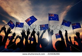 stock-photo-group-of-people-waving-australian-flags-in-back-lit-215936266